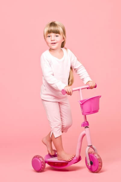 Girl on her Pink Scooter