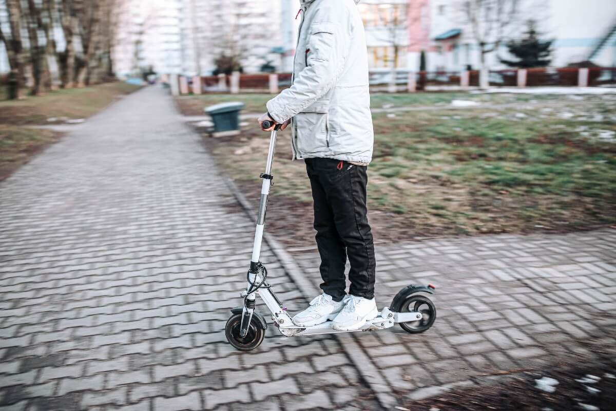 Man riding e-scooter in the street