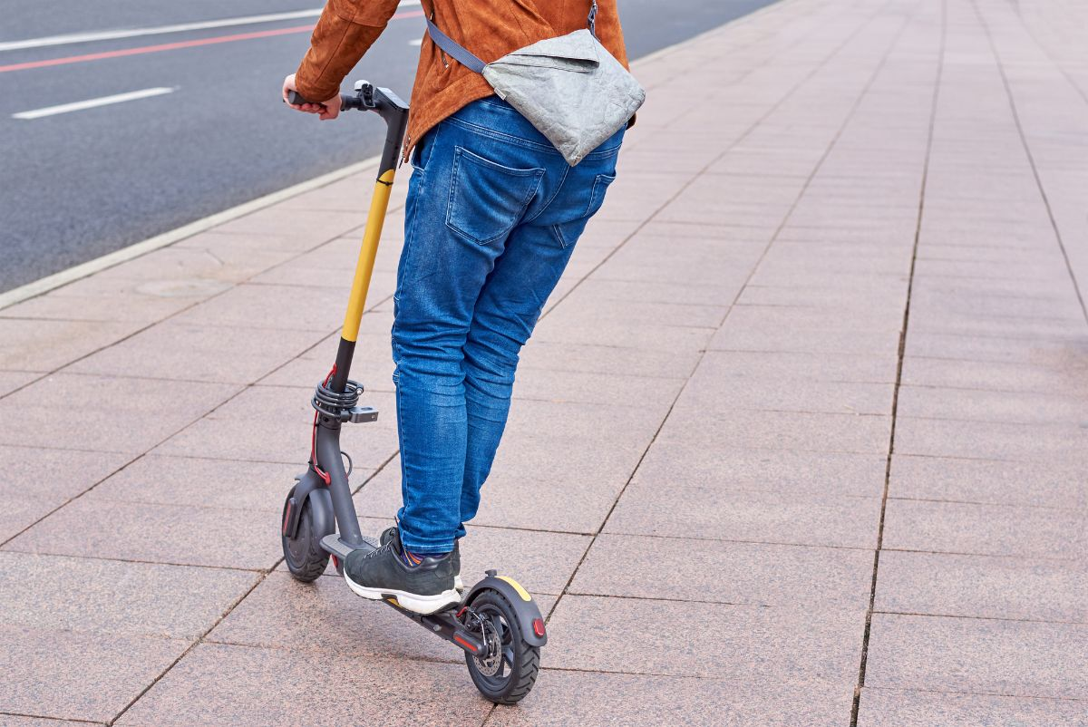 Young man riding Two Wheeled Stand Up Electric Scooter