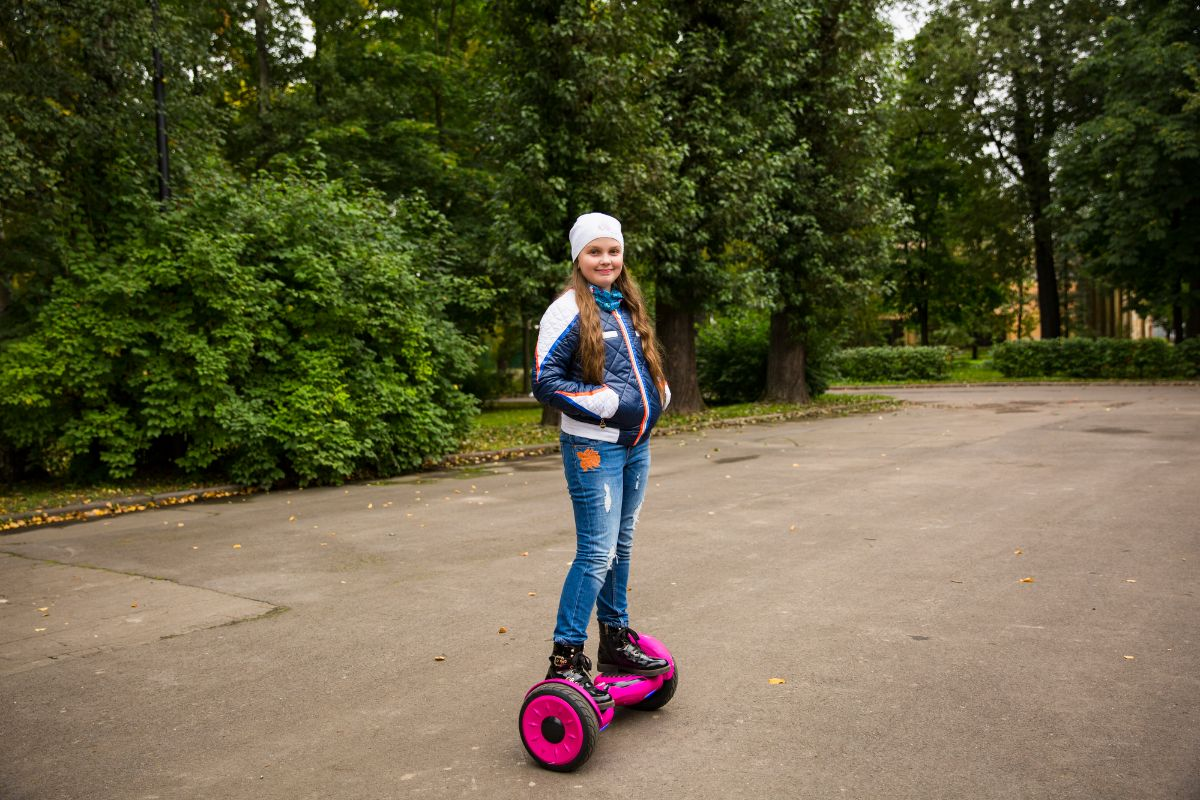 Cute girl riding electric scooter