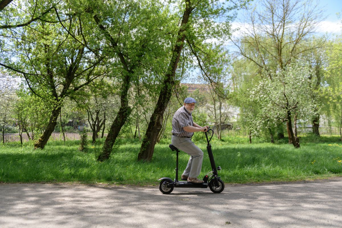 adult man in his electric scooter with seat
