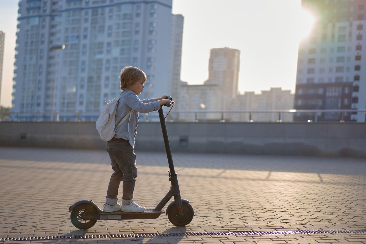 boy riding electric scooter