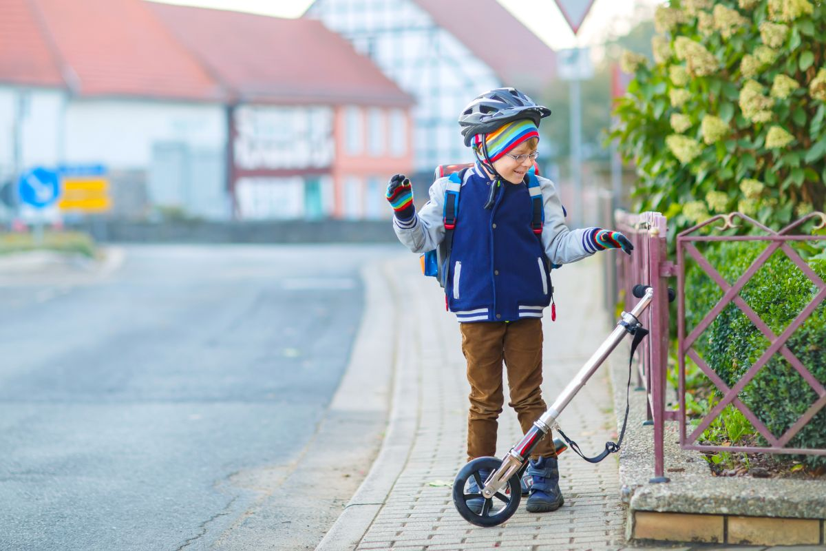 child getting his electric scooter