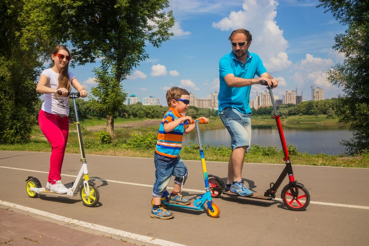 family riding electric scooter