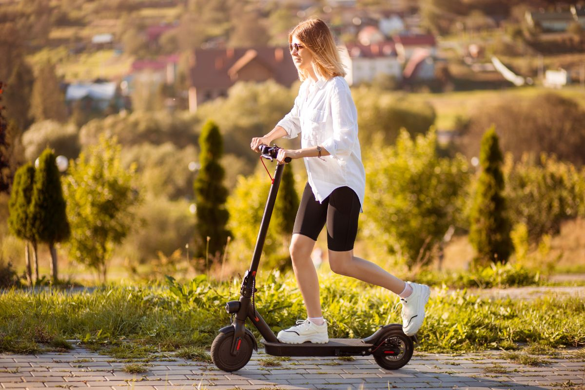 girl in white shirt riding electric scooter