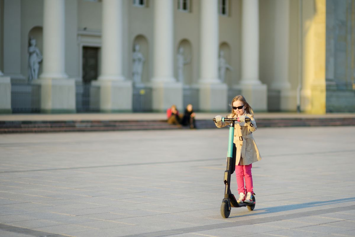 girl riding electric scooter