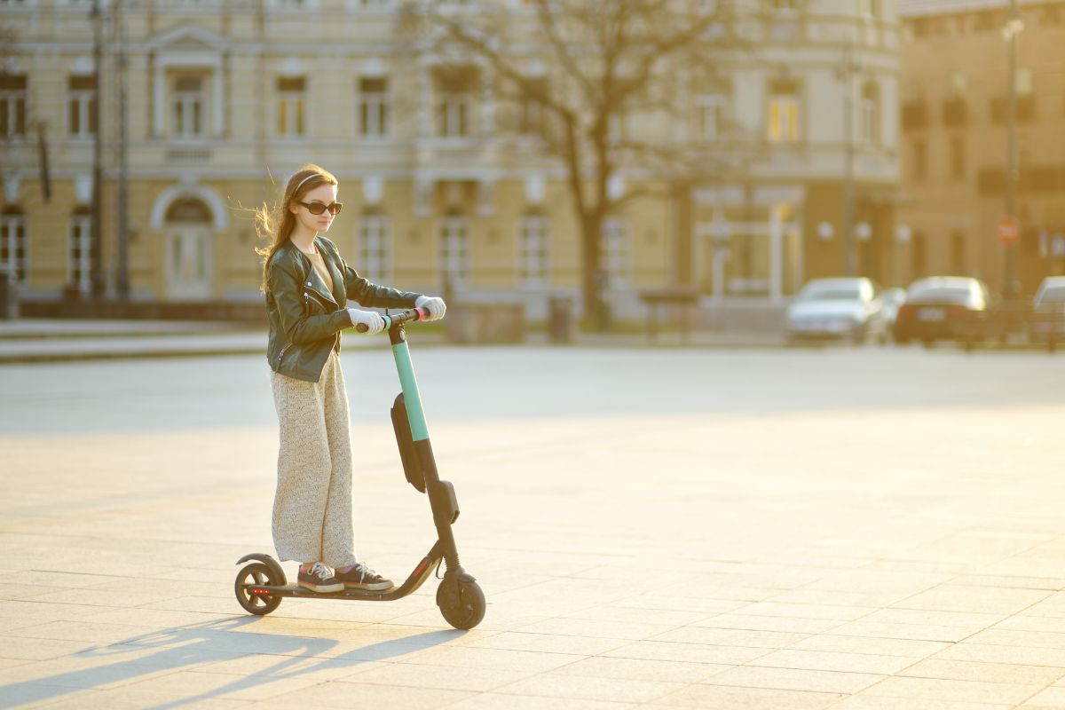 girl riding on her electric scooter