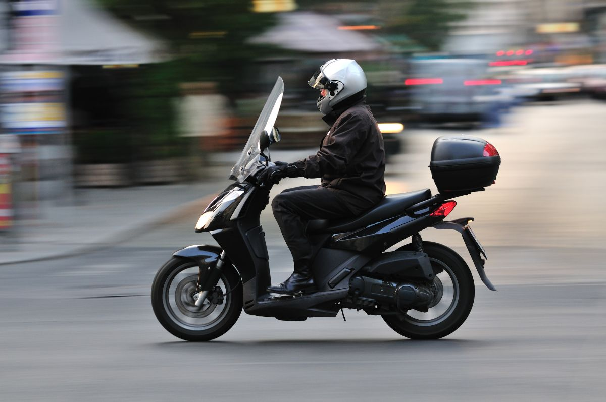 man riding on evo electric scooter