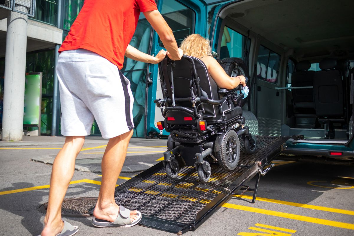 woman on wheel chair pushed thru mobility lift