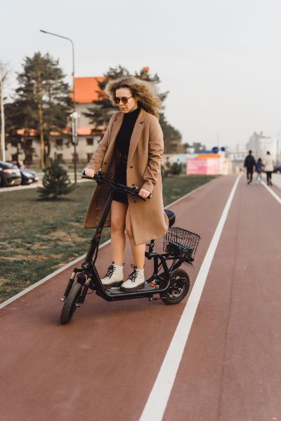 woman standing on electric scooter