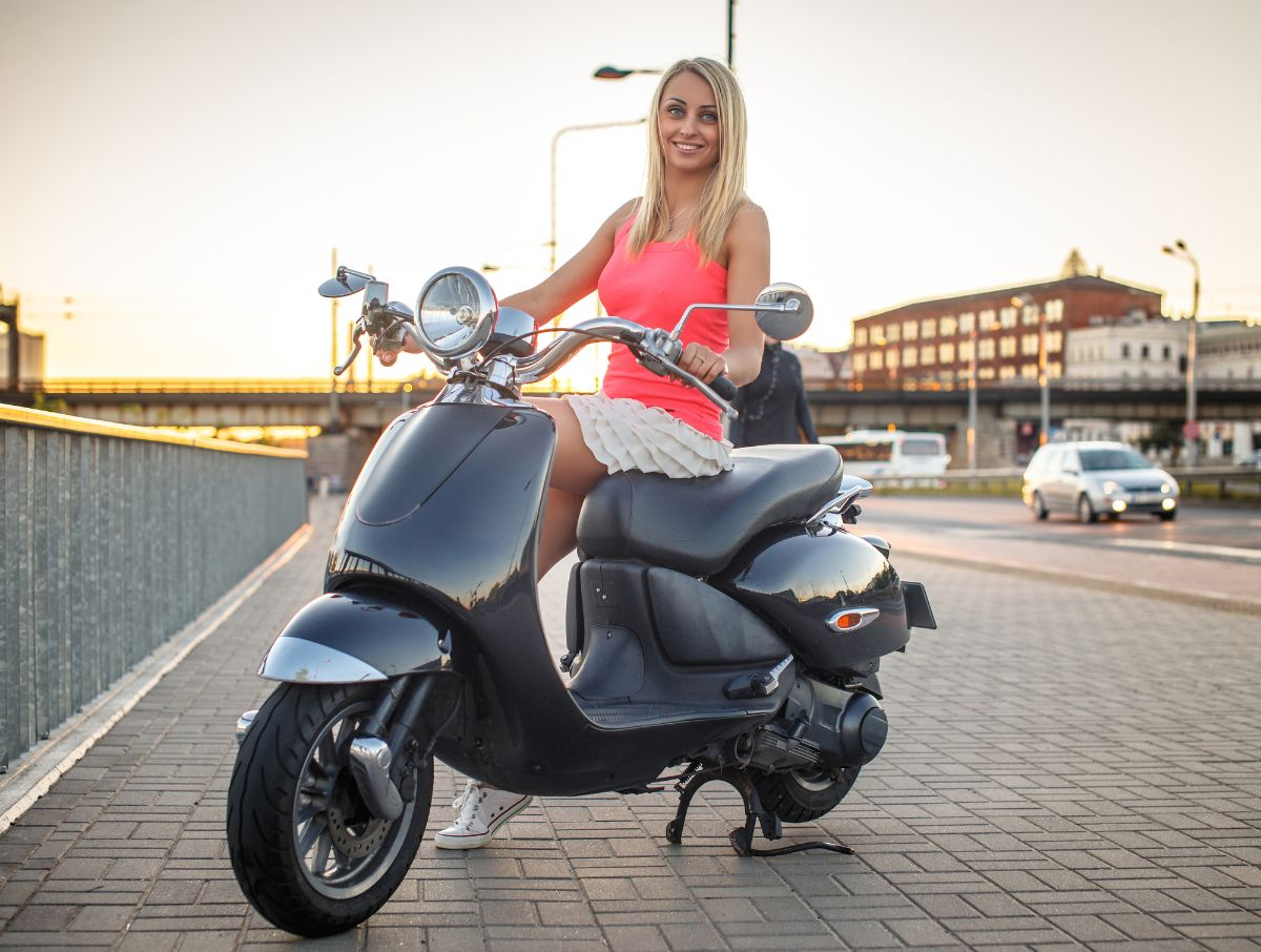 woman with her black evo scooter