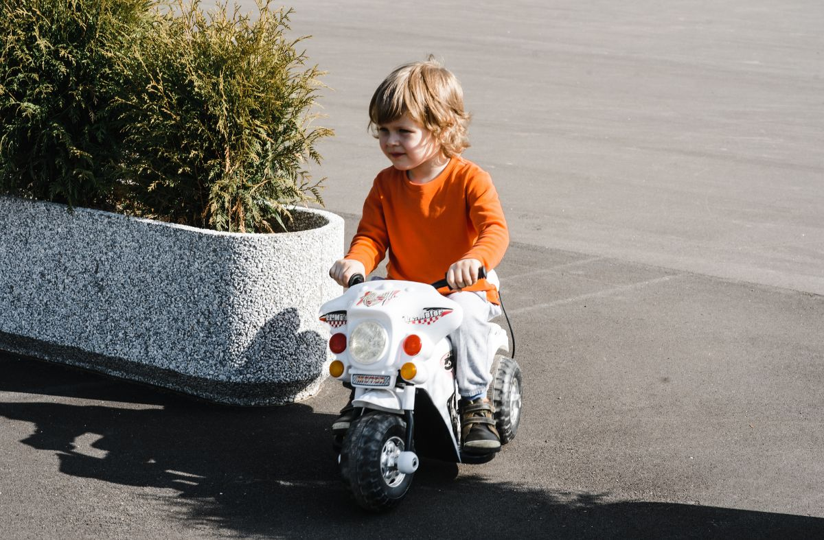young boy riding on his motorbike
